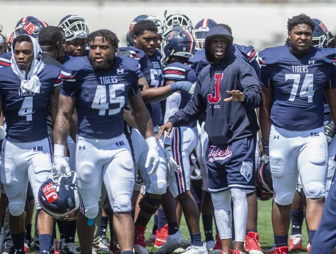 Jackson State head football coach Deion Sanders talks to his team as they prepare to play Alabama A&M on April 10 at Veterans Memorial Stadium in Jackson, Miss.  The NFL legend is one of several high-profile former players to head an HBCU football program.
