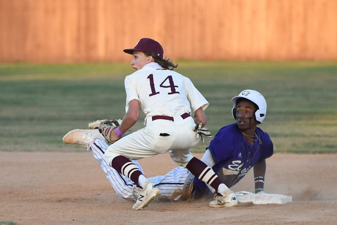 Bastrop's Peter Bacon, left, attempts to tag an Elgin runner during the Bears' 18-4 loss Tuesday.