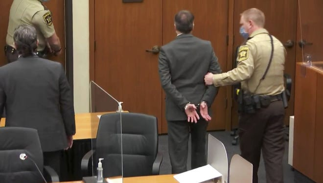 In this image from video, former Minneapolis police Officer Derek Chauvin is taken into custody after the verdicts were read at his trial for the 2020 death of George Floyd, Tuesday in Minneapolis. [COURT TV via AP, POOL])