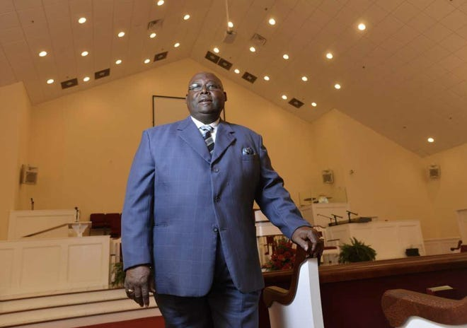 In this 2014 file photo, Rev. Abraham Mosley stands in Mount Pleasant Baptist Church in Athens.