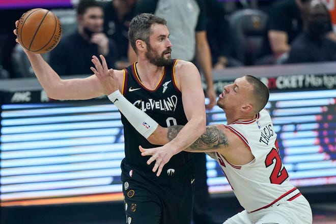 Cavaliers forward Kevin Love shrugs off criticism of his inclusion on U.S. Olympic team but coach Gregg Popovich defends Love's inclusion. [Tony Dejak/Associated Press]