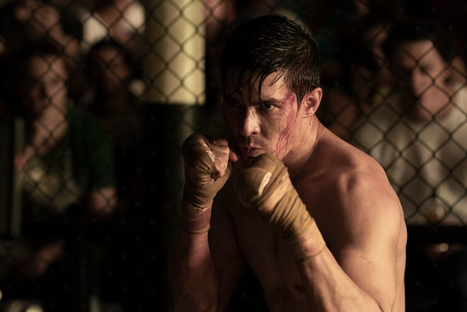 """Lewis Tan is Cole Young in """"Mortal Kombat,"""" which opens in theaters and streams on HBO Max beginning Friday."""