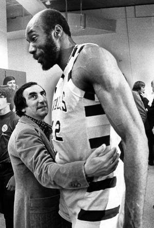 Cavaliers owner Nick Mileti shares a moment with Nate Thurmond on April 28, 1976, after Cleveland beat the Washington Bullets 87-85 in Game 7 of the NBA playoffs' Eastern Conference semifinals.