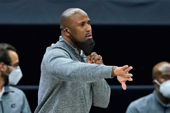Cavaliers assistant coach Greg Buckner gives directions to players during a 121-105 win over the Chicago Bulls on Wednesday night. Bucker filled in for head coach J.B. Bickerstaff, who was away from the team. [Tony Dejak/Associated Press]
