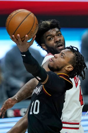 Point guard Darius Garland and the Cavaliers will open the 2021-22 season on the road against the Memphis Grizzlies on Oct. 22. [Tony Dejak/Associated Press]