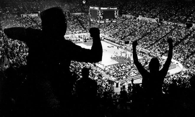 Fans cheer as they watch a Cavs game at the Coliseum in Richfield.