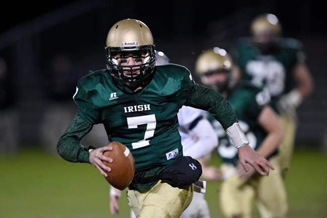 Quarterback Liam Welch runs the ball in the first half as Aquinas High School beat Stratford Academy 35-28 in the Class A private state semifinals in Augusta, Ga., on Friday, Dec. 4, 2015. [JON-MICHAEL SULLIVAN/FILE]