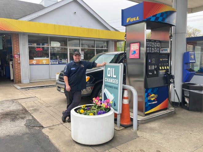 Shawn Wilson, proprietor of Stiles Sunoco on Route 38 in Mount Laurel, strikes a pose at his gas pumps. A Wawa is moving in next door with at least six gas pumps, threatening the long-time family run station.