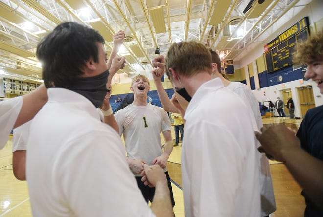 The Vikings celebrate after defeating OLSH Tuesday night at Hopewell High School.  Hopewell won the match 3-2.