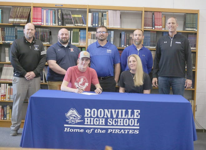 Boonville senior wrestler Brayden McFarland recently signed a wrestling letter of intent with Hannibal LeGrange University in Hannibal, Missouri. On hand during the signing last week in the media center at Boonville High School were (front row, left to right) Brayden McFarland and Heather Shay. (back row, left to right) Boonville Athletic Director Chris Shikles, Hannibal LeGrange Wrestling Coach Daniel Capp, Boonville wrestling coach Justin Hahn, assistant wrestling coach Kyle Newham, and Boonville Principal Tim Edwards.