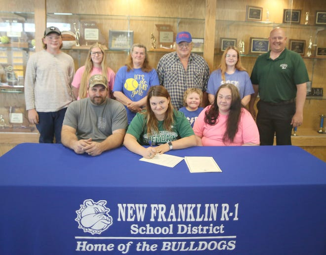 New Franklin senior Kayce Hundley recently signed a letter of intent to play softball at Central Methodist University in Fayette. On hand during the signing last week in the New Franklin High School Commons were (left to right) Matthew Wilkerson, Kayce Hundley, Samuel Wilkerson and Tammie-Hundley Wilkerson. (back row, left to right) Justin Hundley, Heaven-Lee Hundley, Kimberly Hundley, Mark Hundley, Jayna Matthews and New Franklin softball coach Ross Dowell.
