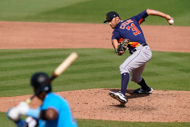 Falmouth native Steve Cishek has a fresh new start in his 11th season, this time with the Los Angeles Angels.  Cishek, then a Houston Astros relief pitcher, throws to Miami Marlins' Lewin Diaz during a spring training baseball game, March 5 in Jupiter, Florida.