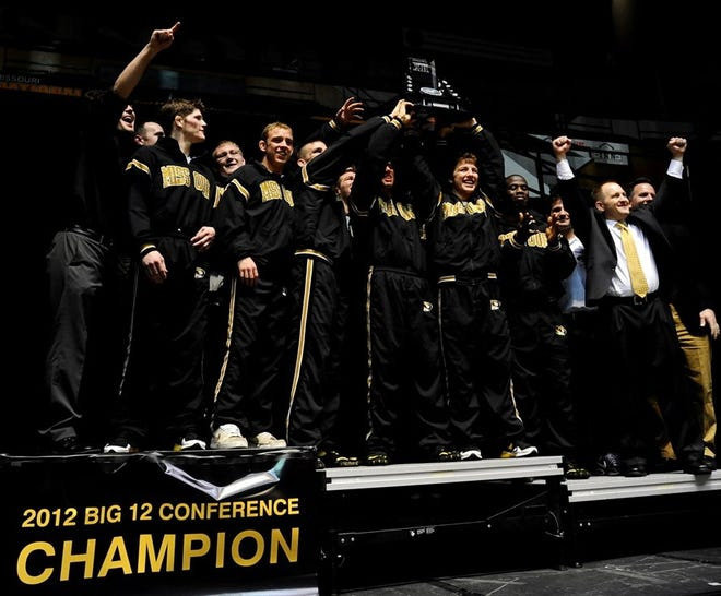 Members of the Missouri wrestling program celebrate their 2012 Big 12 Conference championship at the Hearnes Center.
