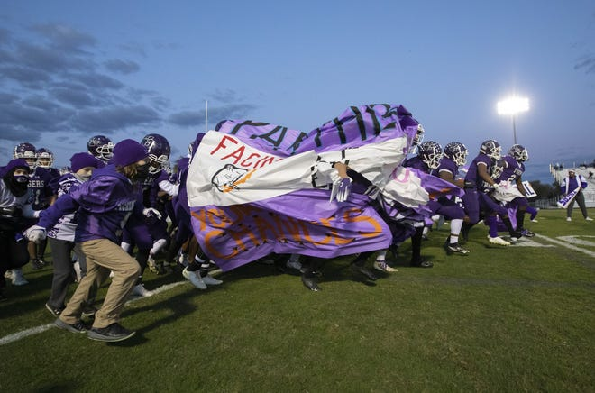 Pickerington Central football players take the field for the start of a second-round playoff game against Hilliard Darby in October.