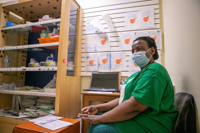 Trio Pharmacy owner Ijeoma Nnani shares details of the COVID-19 vaccination process at her business, at 1570 Cleveland Ave. in Linden.