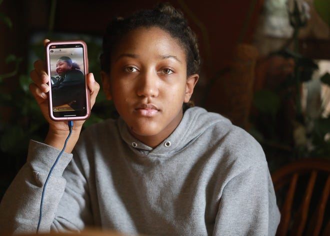 Aaliyaha Tucker holds a photo she took of Ma'Khia Bryant when Ma'Khia was a classmate of hers at Canal Winchester High School. Bryant was shot and killed by a Columbus police officer as Bryant swung a knife at a young woman.