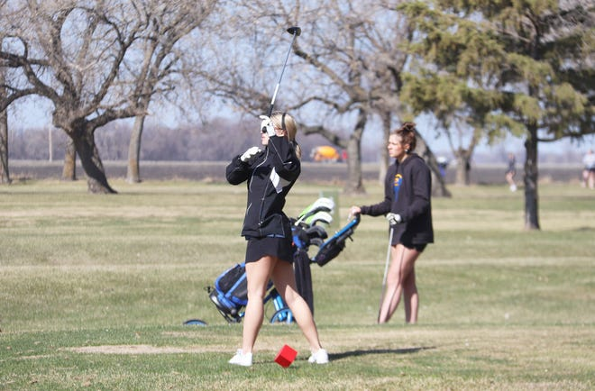 Hannah Brouse watches her shot at Minakwa Golf Course on April 22. Brouse broke 100 for the third consecutive meet on Monday in East Grand Forks.