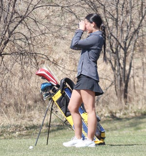 Joslynn Leach uses her rangefinder at Minakwa Golf Course on April 22. Leach shot her best round of the season to finish 11th at Friday's Bemidji Invitational.
