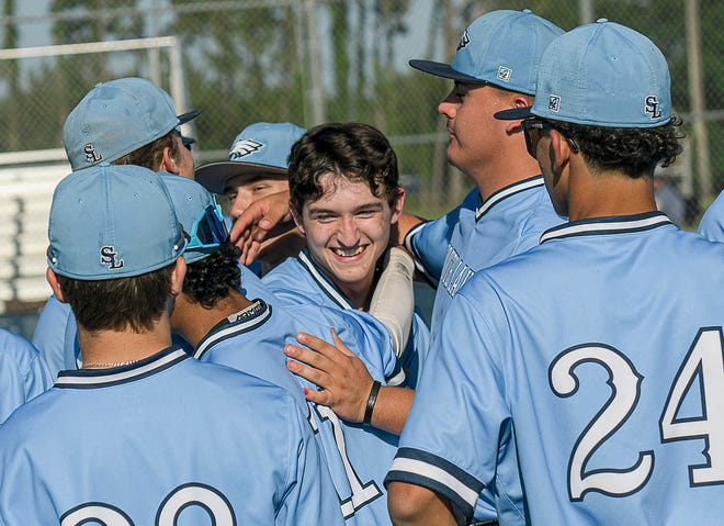 South Lake pitcher Robert Tracy (22) is congratulated by his teammates after throwing a no-hitter against Eustis Thursday in Groveland. [PAUL RYAN / CORRESPONDENT]
