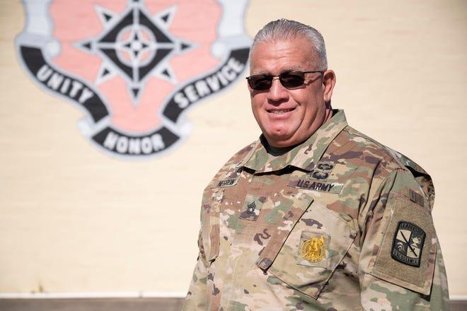 Sgt. lst Class Jose Negron stands outside of Umatilla High School recently.