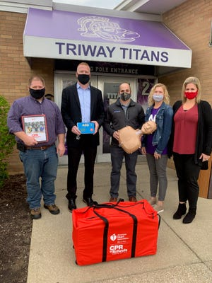 Mike Bogner, co-owner of Bogner Construction, presented the CPR in Schools Training Kit to Triway Local Schools Superintendent Nate Schindewolf alongside Adam Bogner, co-owner of Bogner Construction, Tonya Schmid, the school nurse at Triway Local Schools, and Jenn Fortney, development director for the American Heart Association.