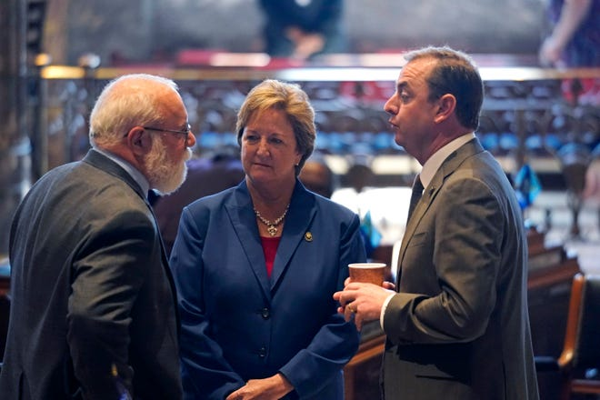 State Sen. Bret Allain (left), R-Franklin, chairman of the Senate Revenue and Fiscal Affairs Committee, talks with Sens. Sharon Hewitt, R-Slidell, and Patrick McMath, R-Covington, during the opening day of the Louisiana legislative session April 12 in Baton Rouge.