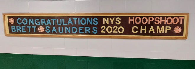 A sign outside the gym at Herkimer Elementary School congratulates Brett Saunders on his success in the Elks' 2020 Hoop Shoot competition.
