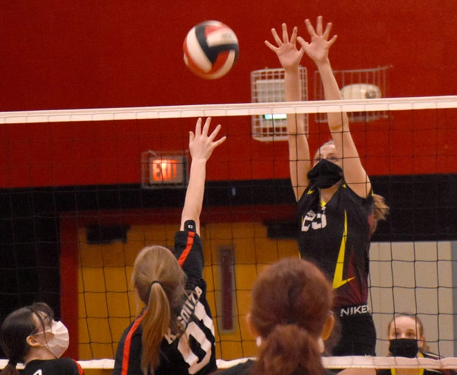 Sarah Paradiso sets up a block attempt for Canajoharie/Fort Plain on a hit by Oppenheim-Ephratah-St. Johnsville's Kaydence Souza (0-1) Wednesday in St. Johnsville.