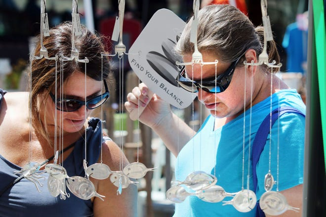 Heidi Boyd, left, and Julie Coleman, both of Burlington, check out the selection of jewelry pieces at the D & G flatware jewelry booth July 20, 2019, during the fourth annual A Very Vintage Market along Jefferson Street in downtown Burlington. A Very Vintage Market has been set for 9 a.m. to 3 p.m. July 17. The Danville-Middletown Citywide Garage Sale will be Saturday.