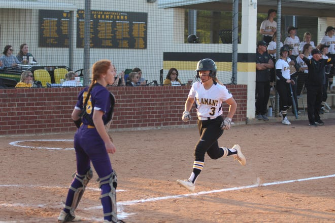 St. Amant's Mary Beth Zeller scores during the Lady Gators' 14-0 second-round victory over Alexandria.