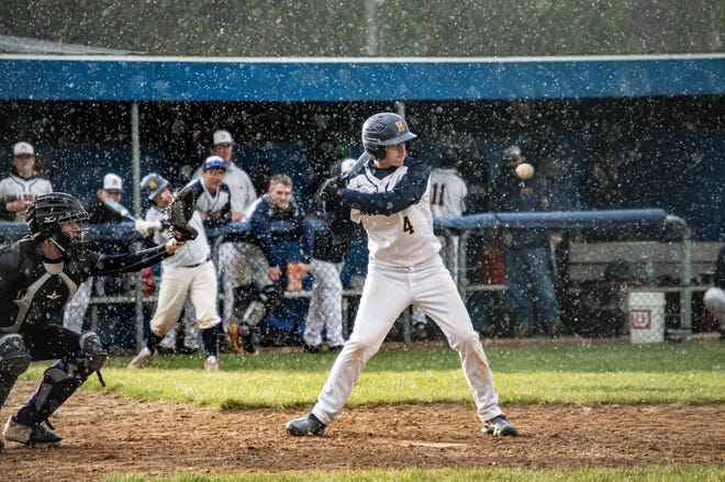 Snowy weather proved a unique challenge for both teams during the double header. Pictured Hillsdale Hornet Gabe Alley.
