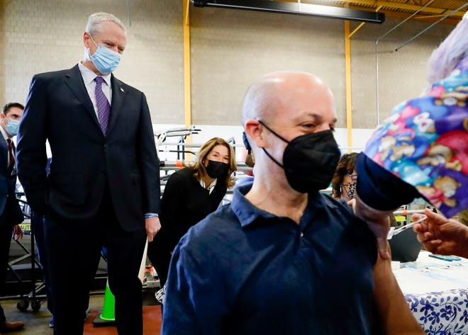 State Senator Adam Hinds receives his first dose of the COVID-19 vaccine as Gov. Charlie Baker and Lt. Gov. Karyn Polito look on, during their visit to the vaccination site at Berkshire Community College in Pittsfield, Thursday, April 22, 2021.