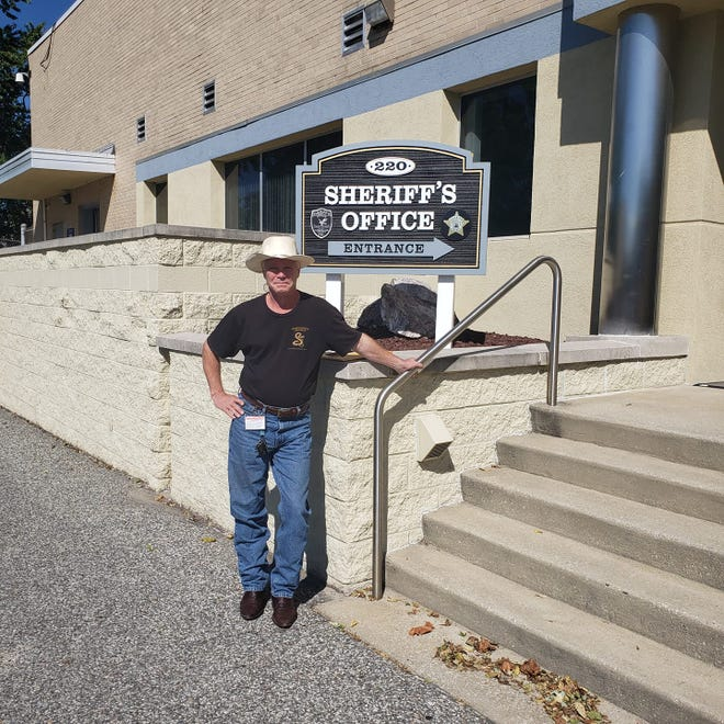 Richard Martin, founder of Constitutional Law Group, poses for a photo outside a sheriff's office. Martin was granted early release from the Ingham County Jail on Tuesday, April 22, after being found in contempt of court in March.