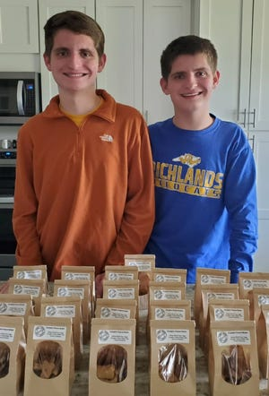 Double Trouble Treat Company's Chase (left) and Hunter (right) Sanford. The 17-year-old twins are diagnosed with autism and the business started as a way for them to develop their occupational skills.