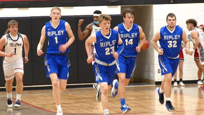 Ripley's Luke Johnson (1), Cade Coode (23), Joey Ramsey (14) and Kadin Hall (32) move down the floor in a sectional tournament game against Nitro. The Vikings fell to Nitro to end their season. Johnson led the team in scoring during the 2021 season campaign recording an average of 14.4 points per game.