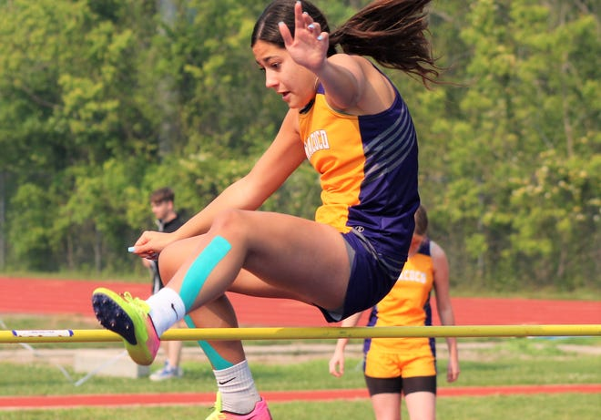 Anacoco's Joanna Mawae, seen here soaring over the high jump bar, and Brayden Prichard each won three events on Wednesday during the District 5-B Championships held at Leesville High School.