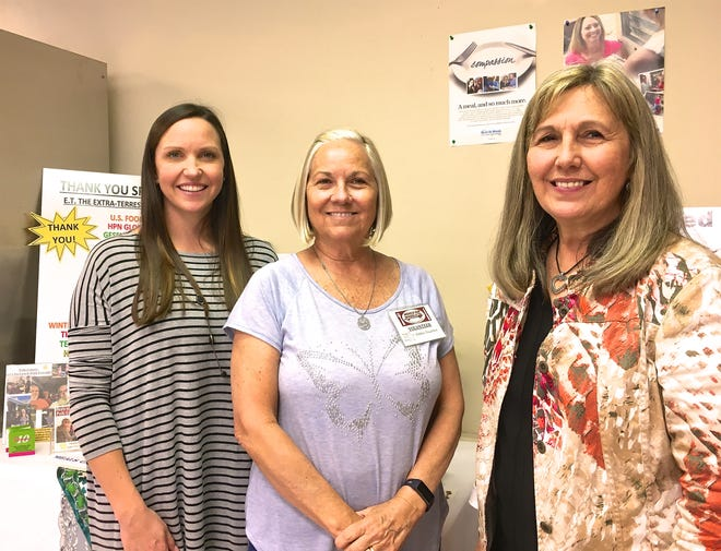 Meals on Wheels of Polk County President Cari Herrington, MOW's newest board member Debbie Touchton and MOW Executive Director Susan Eldridge get together after the organization's April meeting where Debbie Touchton was officially installed as a director, left to right.