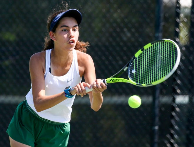 McKeel eighth-grader Jada Hutto hits a backhand shot to Cypress Lake's Estrella Mostacero during their match at No. 3 singles on Wednesday at the Kelly Recreational Complex in Lakeland. Hutto won, 6-0, 6-0.