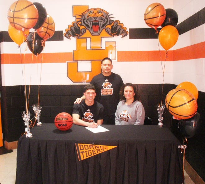 La Junta High School's Thomas Garcia (front row left) signed a national letter of intent to play men's basketball at Doane University. Also pictured are his father, Adam Baca, and his mother Michelle Montoya.