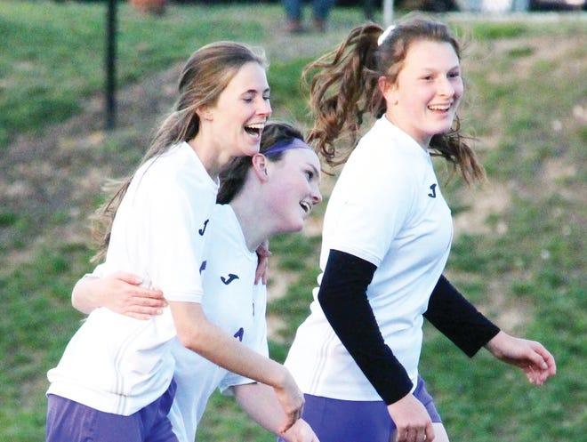 Camdenton junior Alli Johns (left) celebrates a goal with senior Olivia Brown (center) and junior Alexa Rapier (right) on April 21 in Osage Beach.