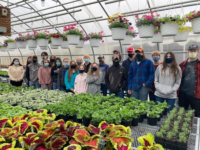 The Mineral County FFA will open its greenhouse, located at the Mineral County Technical Center, on Monday, April 26. Horticulture students have been working hard to grow a variety of plants to serve the community. The hours will be noon – 5 p.m. Monday- Friday while supplies last. All proceeds return back in the horticulture and FFA program. Please wear a mask, social distance, and cash or check only. MCTC students pictured in the greenhouse are: Front: Nick Ortt, Lilly Courrier, Brookelyn Keller, Racheal Rutherford, Savannah Grimmet, Sadie Portillo, Kenzie Rohrbaugh, Tyler Moon, Roy Ketterman Jr, Laynee Leatherman; Back: Megan McDonald, Destiny Moxley, Lucas Ray, Rylee Lyons, Kyleigh Fazenbaker, Trever Clauze, Chandler Long, Bradley Sommers, Garrett Hart, Jerimiah Dolly, Nicholas Johnson. Not pictured: McKenzie Paugh, Iryll Jones V, Dalton Dent, Alexis Liller.