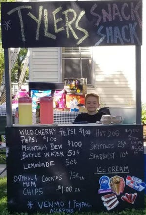 """Monroe resident Tyler Kunzelman, age 8, started """"Tyler's Snack Shack"""" and donated half of his profits to the Humane Society of Monroe County."""