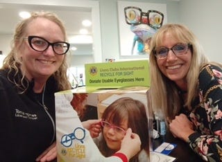 Tonia Holmes and Treena Thompson from the Canandaigua Lions Club collect used eyeglasses from a collection box. The club also accepts used hearing aids. Boxes are set up at the following local businesses: Dr. Geoff Hallstead; I Care for Eye Care, Dr. Felix Tao; Canandaigua YMCA; Canandaigua National Bank, Downtown and Lakeshore; The Eye Care Center; Walmart Vision Center; VA Medical Center; Elm Manor Home for Adults; Quick Print; Wood Library; Wegmans; Aberle Eye Care; St. Mary's Church; Clark Manor; Clark Meadows; Eighty Parrish Street Apartments; Ferris Hills at West Lake; Fort Hill Apartments; Quail Summit; Thompson Apartments; Horizons Senior Living Community Ontario Center, County Home; and Finger Lakes Shipping Center.