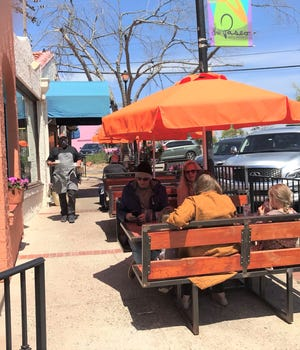 Chef Ryan Parrott walks food out to sidewalk diners at Picasso's Cafe in Oklahoma City's Paseo Arts District.