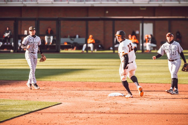 Oklahoma State's Carson McCusker, center, reaches second in a 12-2 win over Arkansas-Pine Bluff on April 21.