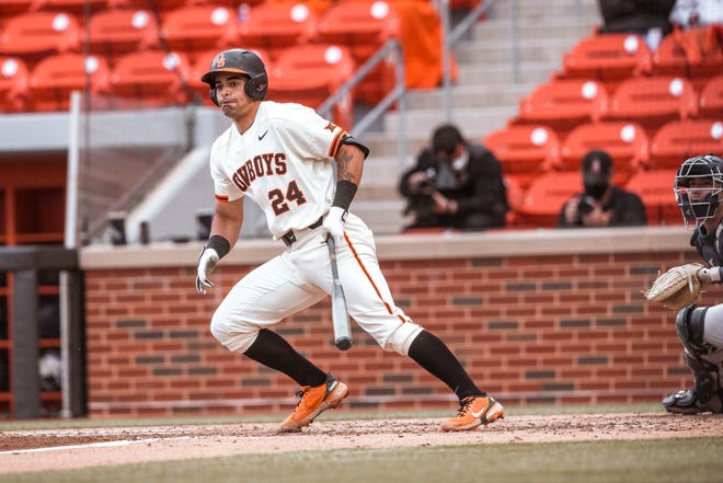 OSU's Christian Encarnacion-Strand reacts to a hit against Oral Roberts earlier this season.
