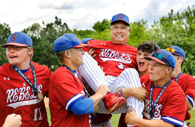 Silo baseball players life coach Billy Jack Bowen after winning the Class 2A state title in 2019.
