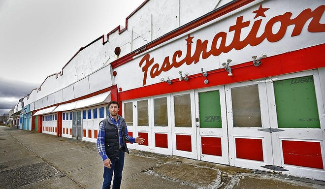 Paragon Boardwalk General Manager Chas Boggini stands in front of the strip of Nantasket Avenue businesses he is trying to revitalize.
