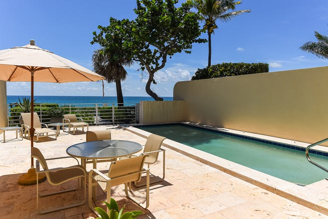 The townhouse at 9 Sloan's Curve in Palm Beach has a private pool within a walled courtyard overlooking the Atlantic Ocean.