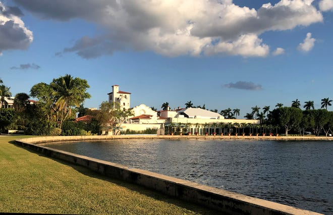 With its Mediterranean-inspired architecture, The Everglades Club fronts a cove on the Intracoastal Waterway.